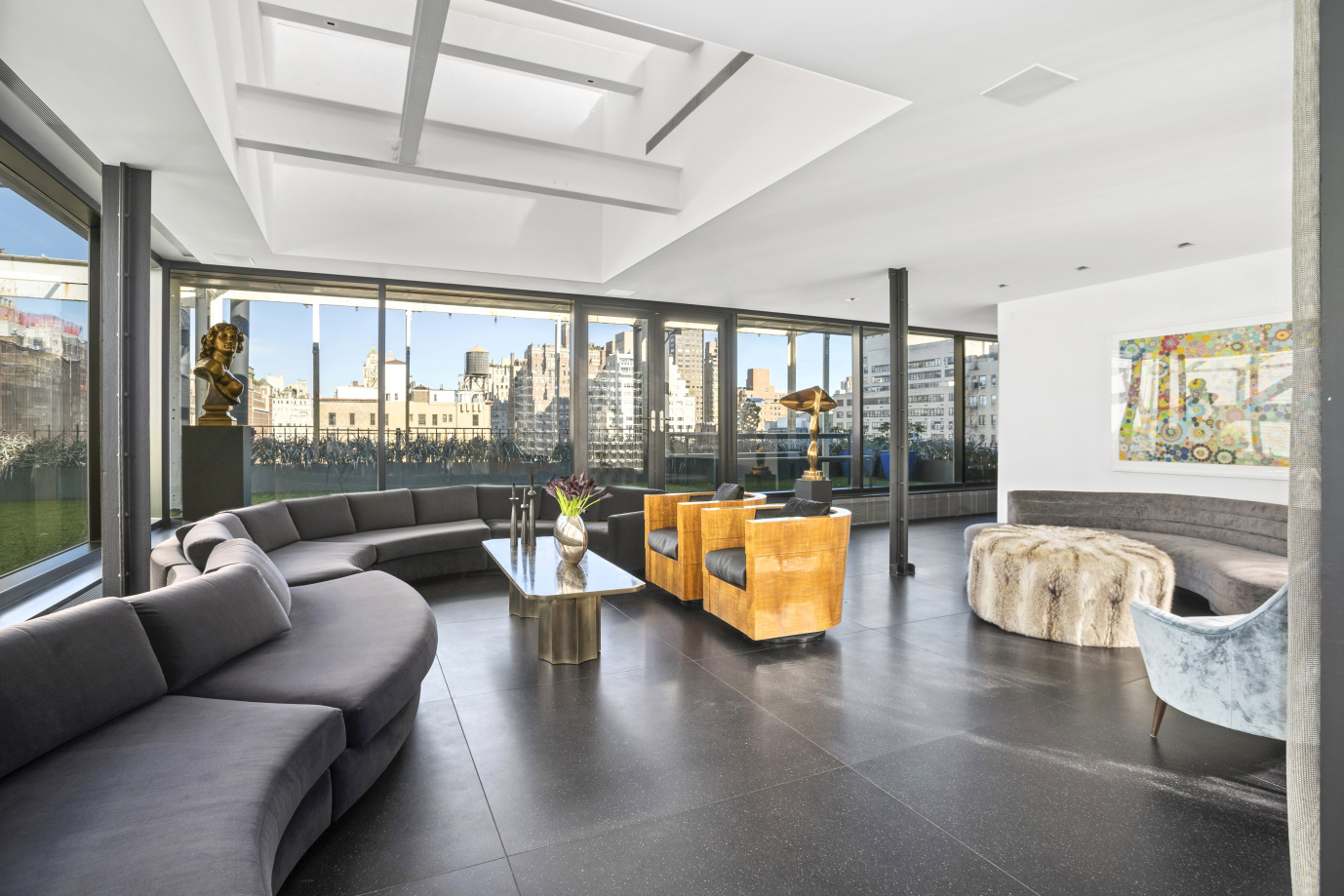 Come see the heights of Manhattan penthouse living at 45 East 66th Street, where one can purchase a renovation equal to those in the best new developments for less than half the cost. This open-concept duplex residence offers approx. 4,020 sq. ft. of living space surrounded by 3,455 sq. ft. of set-back terraces, ideal for sophisticated entertaining.  Featuring a flexible 4-5 well-proportioned bedrooms, 4.5 luxurious bathrooms, a corner living room with large skylight, an enormous dining area, a chef's dream kitchen with separate breakfast area, all surrounded by a wall of glass, filling the space with non-stop natural light. There is also a fully equipped laundry room, a media room or den, and work-station.  Features include multi-zone central air conditioning, soundproof architectural floors, private water pumps, and amply upgraded electric power, along with new windows. This sought-after co-op also allows 50% financing, and pets are welcome with board approval. 2.5% flip tax.  ENTRY Private elevator landing welcomes you to a windowed entry foyer.  LIVING ROOM Grand corner living room with large skylight and glass walls with access to terrace  DINING AREA An enormous dining area that can easily accommodate 30 guests making it a perfect setting for those unforgettable dinner parties. There is also an exquisitely designed powder room.  WINDOWED EAT-IN KITCHEN The kitchen, with a separate breakfast area features solid 4' thick marble countertops, stunning Arclinea copper cabinetry and drawers, a vented cooktop with oven and convection oven.  PRIVATE SPACES A Cerused Oak pocket door separates the entertaining space from the private living space, which has wide-plank Siberian oak floors throughout. There are three well-proportioned bedrooms, a media room, four luxuriously appointed bathrooms, three of which are en suite, and a utility/laundry room with two sets of vented washer & dryers. There is also a spacious work station lounge under the cantilevered stairway that l