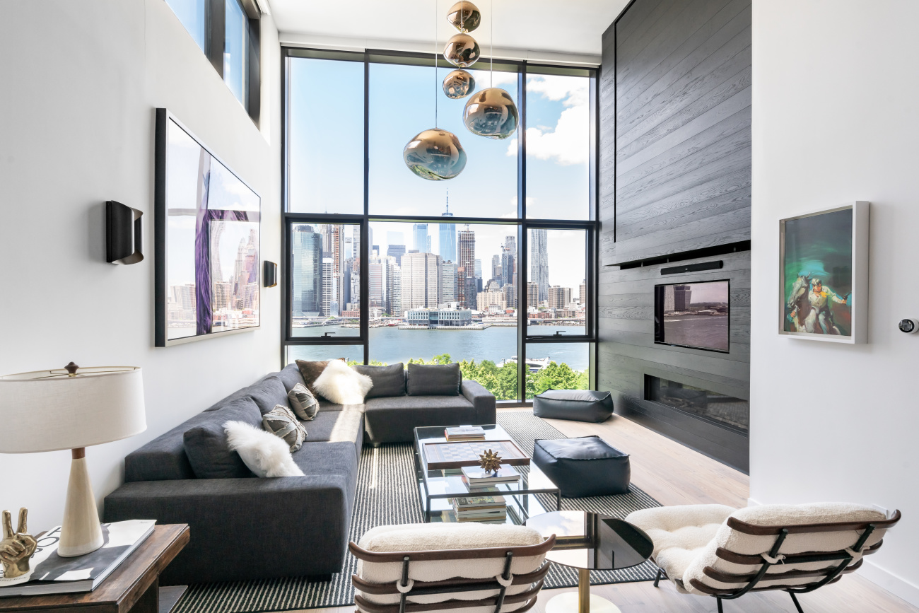 Now showing by appointment. Contact the listing agent to schedule a private tour.  Welcome to this townhome-style, Triplex Penthouse Masterpiece at Pierhouse, Brooklyn Bridge Park. This stunning 4 bedroom, 3.5 bathroom home is spread over nearly 3,200 luxurious sq. ft. with an additional almost 2,000 sq. ft. of private landscaped outdoor space on 2 levels, maintained by the building. Every detail has been attended to in this superbly designed penthouse level home. This perfectly positioned residence offers views that are second to none with protected, unobstructed views of the Manhattan Skyline, Brooklyn Bridge and the Statue of Liberty. Soaring 18 foot ceilings in the living room with oversized windows flood this home with gorgeous light all day and create the perfect frame for these mesmerizing views.    Enter the open plan main floor foyer with custom walk-in entry closet and marble powder room and be drawn into an entertainer's dream.  The gracious large Dining Area is the perfect place for stylish entertaining.  The comfortable breakfast/living area is flooded with light and leads to the first private terrace with room for outdoor dining with magnificent views. The luxurious Chef's Kitchen includes Gaggenau appliances, including 2 dishwashers, double ovens, espresso machine, Calacatta Tucci marble slab island and counters, gorgeous solid walnut kitchen cabinets and an 18-bottle wine refrigerator. The walk-in pantry room has been upgraded with an additional Bosch refrigerator and custom shelving.   Be amazed at the truly special massive private roof deck on the upper floor, with its multilevel sitting areas and gas grill. With sweeping 360 degree views, this impressive space is an exceptional outdoor oasis.   Alight the main staircase into the grand living room with its Tom Dixon chandelier and dramatic double height wall of windows facing the river and Manhattan Skyline. This elegant space features a custom oak wall with gas fireplace and integrated media and leads to a cozy den and office area with custom built-ins. The king-sized Master Bedroom Suite also has incomparable views and two custom rifted oak walk-in closets.  Enjoy relaxing in the spa-like marble-clad master bathroom with radiant heating, double sinks, separate steam shower, deep soaking tub and Waterworks fixtures.   Three additional well-sized bedrooms line the back of the apartment with bright, broad views over Brooklyn.  Additionally, there are 2 beautifully appointed Full Bathrooms.  A convenient laundry room, electric solar shades, nest thermostats, custom pine flooring, and abundant custom built-ins finish this spectacular designer home.   Pierhouse's exclusive amenities include two 24-hour attended lobbies, on-site valet parking garage, two fitness centers with CrossFit equipment, meditation and yoga studio with barre, playroom, pet-wash, residents lounge with kitchenette and projector screen, conference/dining room, package room, refrigerated storage, and bike storage. Pierhouse residents also have special access to 1 Hotel Brooklyn Bridge's spectacular rooftop pool. 1 Hotel Brooklyn Bridge also offers a farm-to-table restaurant, a cafe, a world-class spa, a screening room, event spaces, and elegant bars and lounges with some of the best views in the city. Close to world-renowned restaurants, shopping, culture and history of Brooklyn Heights and Dumbo, Pierhouse raises the bar for luxury city living.  Set along the waterfront in beautiful Brooklyn Heights, Pierhouse is in a special position to take advantage of all the iconic Brooklyn Bridge Park has to offer right at its doorstep. Enjoy breathtaking sunsets over the East River, and access to over 85 acres of phenomenal recreation space including dog runs, playgrounds, trails, picnic areas, lawns, soccer fields, basketball courts, volleyball, handball, roller skating, kayaking, and sailing via the spectacular ONE15 Brooklyn Marina. Enjoy the convenience and excitement of Brooklyn Bridge Park Conservancy's free year-round programming, activities and events.  A convenient commute to Manhattan via multiple subway lines (F, A, C, 2, 3, 4, 5, R) or the NYC Ferry service allows plenty of extra time to enjoy all that Pierhouse and the Brooklyn waterfront have to offer.
