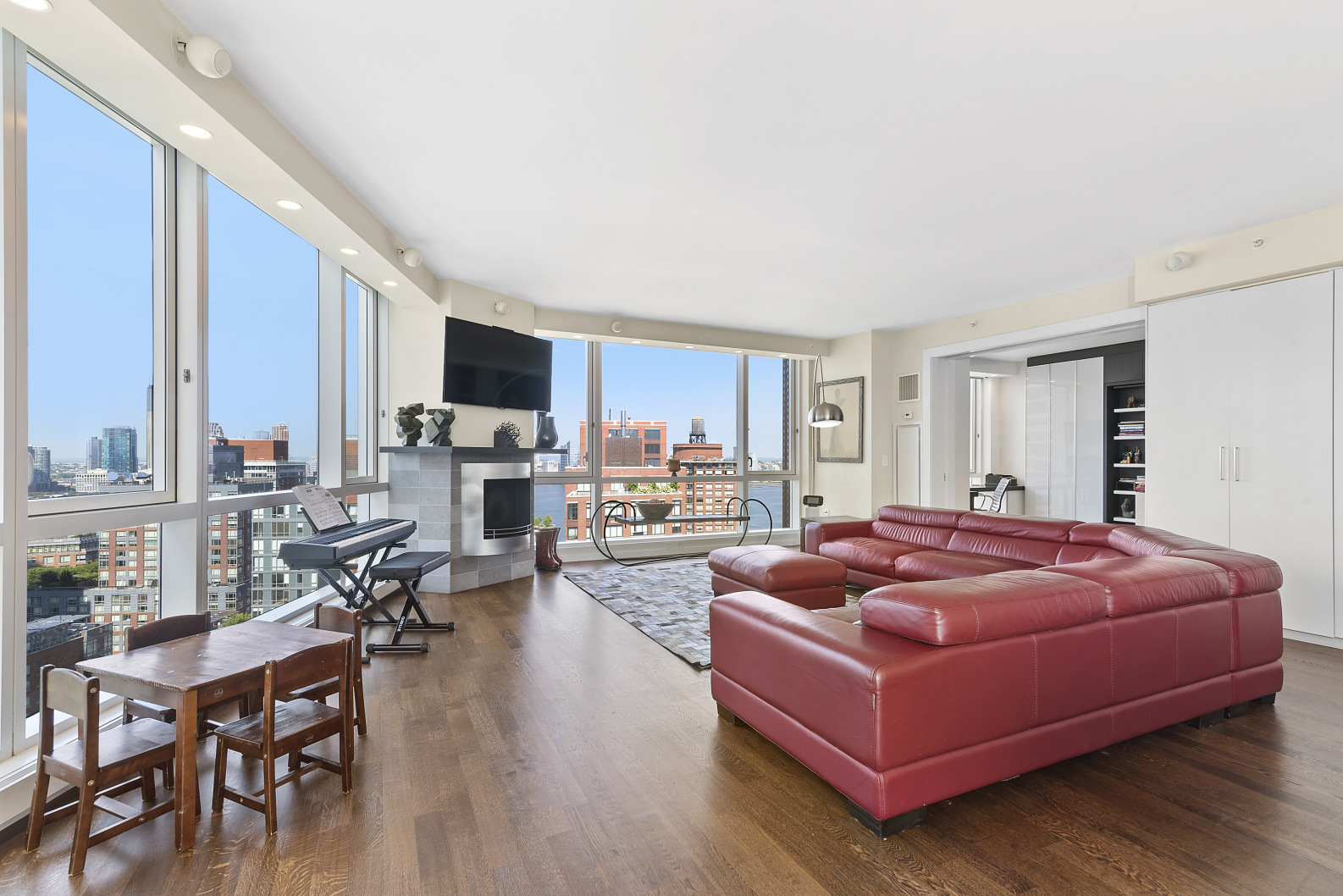 """Those wishing to attend the """"open house by appointment"""" must first inquire to schedule an appointment beforehand.Located on one of the highest floors of Tribeca's first luxury high rise condominium, apartment 27A offers a sprawling 2,200 square feet featuring 9' ceilings, 3 bedrooms, 3 full bathrooms, and 3 exposures (East, South, West). Endless views await through floor-to-ceiling windows found in every room of the home. The oversized corner-great-room (measuring 37' X 21') comfortably holds an open chef's kitchen with premium appliances, formal dining area, and an expansive living room with a working gas fireplace.No expense was spared when the home was upgraded to include Somfy motorized shades covering all windows (including both solar shades + blackout shades in bedrooms), Lutron lighting throughout, walls of custom built-in storage in every room, beautiful dark stained hardwood floors, and a sound system. The installation of a sliding panel pocket wall allows the 3rd bedroom to double as a home office complete with a cleverly concealed murphy bed behind the shelving (see video tour for a demonstration of the murphy bed). A gracious foyer is found at the entrance of the home, and down a nearly 30' hallway one finds the spacious bedroom ensuite, 2nd bedroom, and additional bath. The ensuite bathroom has a walk-in glass shower and double sink vanity, the second bathroom has a deep soaking tub, and another walk-in shower is found in the 3rd bathroom. Two pullout desks are concealed in wall of storage in the 2nd bedroom.The open chef's kitchen features granite countertops, a subzero refrigerator, viking gas range, Miele dishwasher, 2 refrigerated drawers built into the extended island, and 2 side-by-side refrigerated wine storage units.200 Chambers Street is Tribeca's first luxury high rise development, designed by acclaimed architects Costas Kondylis & Partners and developed by Jack Resnick & Sons. The magnificent double height ceiling lobby is attended 24 hours b"""