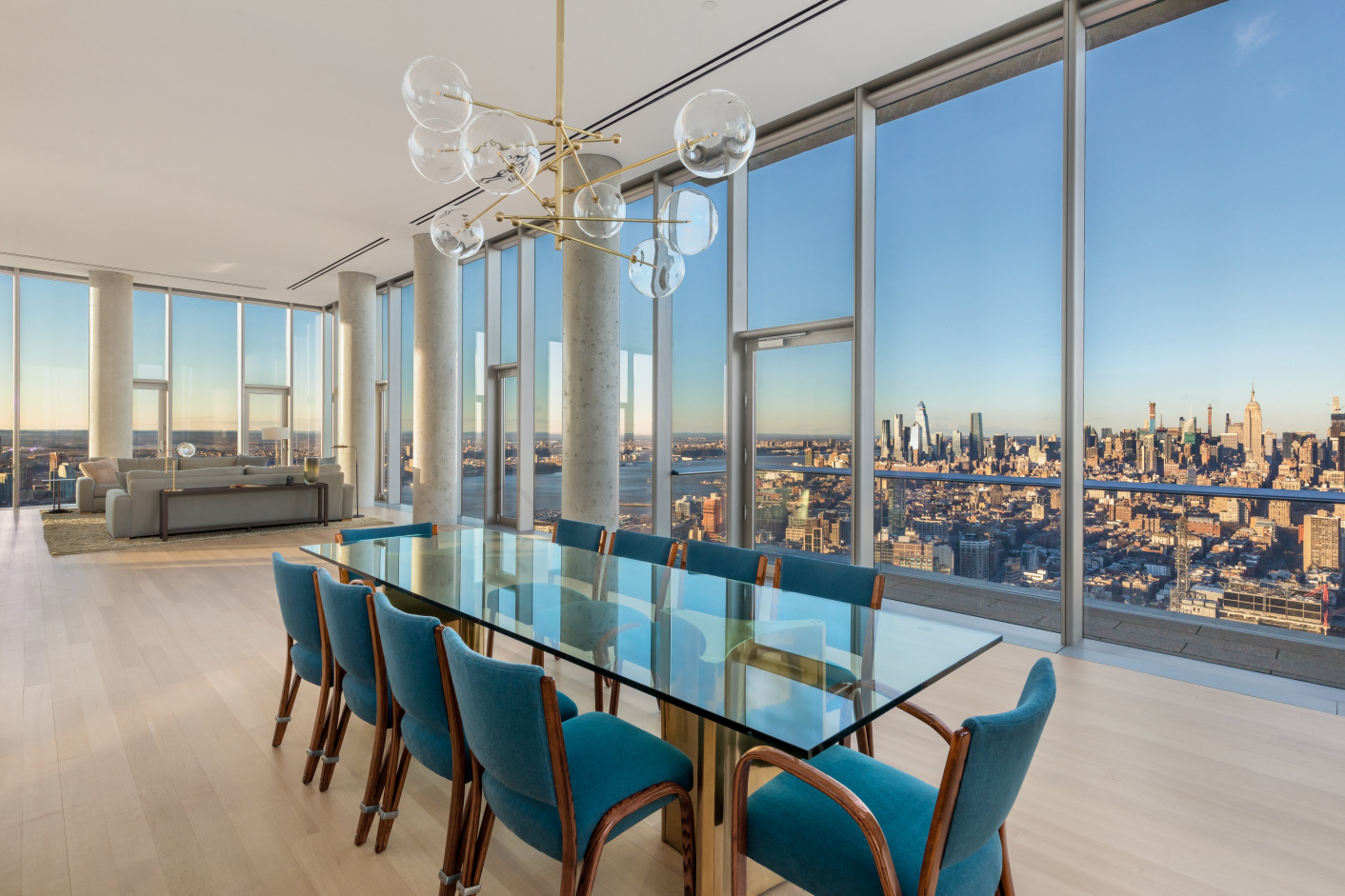 INTRODUCING THE LARGEST PENTHOUSE IN 56 LEONARD  Towering over downtown Manhattan, this penthouse in the sky is perched atop the iconic 56 Leonard Street, a pillar of historic Tribeca. The home's 360 degree views of Manhattan are unrivaled and indescribable. Spanning 6,400 square feet of space and three private terraces, this distinctive residence is the largest floor plate in the building.  Through a private key-locked elevator, enter the 53rd floor where you are welcomed by soaring 14-foot ceilings and walls of windows. This glass enclosed chateau reveals a backdrop of Manhattan stretching north, east, west, and south. The lavish great room is flanked by a wood-burning fireplace and west-facing terrace with sweeping water views.  Wrapping around to the right of the great room is a formal dining area with breathtaking northern views all the way up to the Empire State Building. Continuing past the dining area is an enormous chef's kitchen, uniquely crafted by Herzog & de Meuron featuring an Absolute Black granite grand piano-shaped island and custom-sculpted fully-vented range hood. Satin-glass etched cabinetry surrounds a modern selection of premium Miele and Sub-Zero appliances. Off the kitchen and dining areas is an unprecedented 1,000+ square foot wraparound terrace where one can throw extravagant parties and ogle the staggering views north and east across the city.  Sunlight bounces off the Appalachian white oak flooring throughout the home, illuminating all four bedrooms and showcasing a superb, unparalleled design. The master suite revels in the beauty of the city below, with triple exposures north, east, and south offering jaw-dropping views of the East River and One World Trade Center. The expansive 17 x 36 bedroom features a seating area, three large walk-in closets, an en-suite bath, and access to the wraparound terrace. The five-piece master bath is appointed with travertine floors and Thassos marble mosaic tile walls. The Herzog & de Meuron custom desig